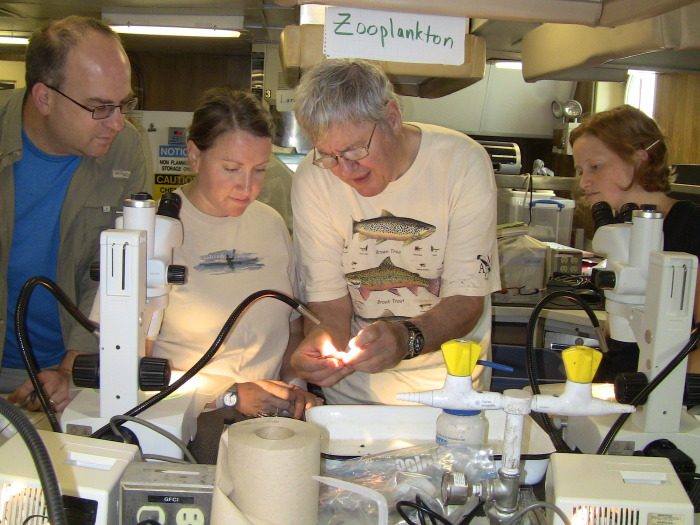 Educators working up samples with Dr. Jude on Lake Huron in 2012.