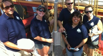 Dr. Mason poses with the rest of the science crew and the manta trawl during the first ever survey for plastic pollution within the Great Lakes.