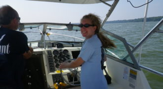 Jeanette at the helm of the RSC research vessel.