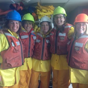 Teachers ready to go on the fantail of the ship for water quality data collection.