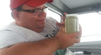 Doug Kane contemplating a plankton sample taken from Lake Erie aboard the RV Erie Monitor.