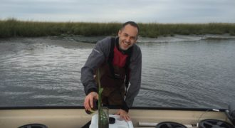 Tim Hoellein collecting water and sediment for measurements of nitrogen transformations