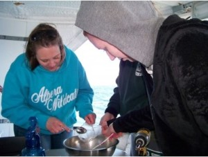 Alpena teacher Melissa Smith sorts trawl samples with students aboard the Nancy K research vessel. Helen-Ann Cordes | Michigan State University Extension.