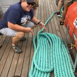Lori Haak shows of a rope she coiled on the Denis Sullivan